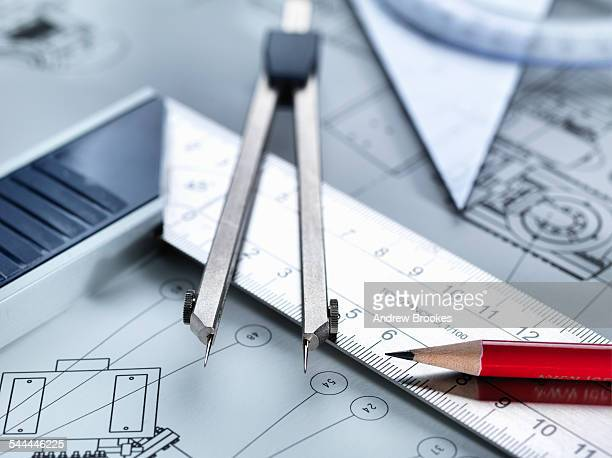 Drawing equipment sitting on engineering drawing
