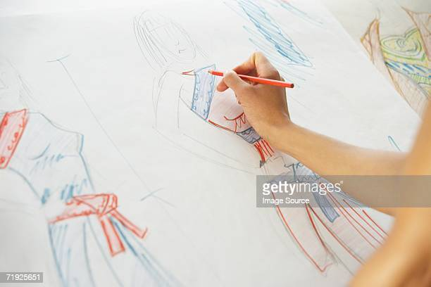 drawing fashion designs - fashion designer stock photos and pictures