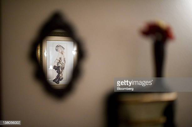 A drawing hangs in the parlor of the Chicken Ranch brothel in Pahrump Nevada US on Thursday Jan 26 2012 The Nevada Republican presidential caucus...