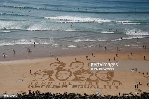 TOPSHOT A drawing in the sand made by Sam Dougados of the GNO One depicting leaders of the world's seven richest democracies Britain Canada France...