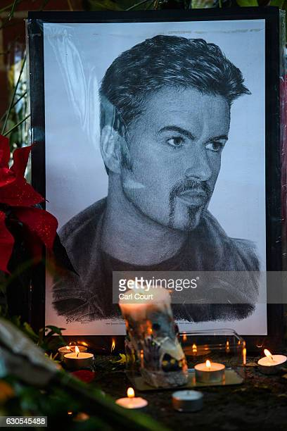 A drawing is left with flowers and tributes outside the Oxfordshire home of British pop singer George Michael on December 26 2016 in Goring England...