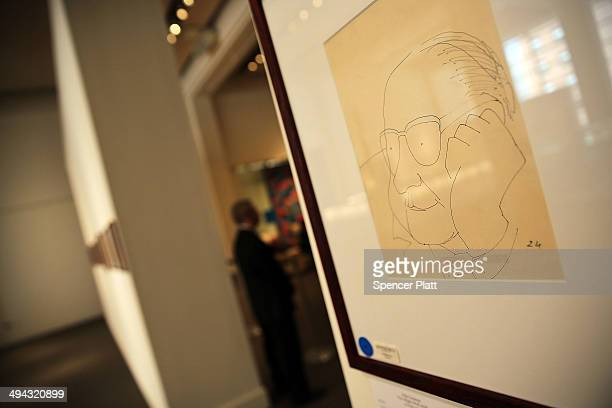 A drawing is viewed as part of a collection of letters poems and drawings from John Lennon to be auctioned at Sotheby's auction house on May 29 2014...