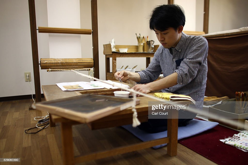Drawing master Ryugo Yamamoto mixes paint to apply to a design on kimono fabric during a stage of its production process at the Sensyo Ichikawa kimono workshop on April 26, 2016 in Kyoto, Japan. The workshop employs a traditional method of dyeing called Kyo-Yuzen. Unique to Kyoto it is used to dye silk fabric for kimonos by hand-painting with natural dyes made from flower petals. The technique can be divided into 26 processes and each part is handled by the master of that process.