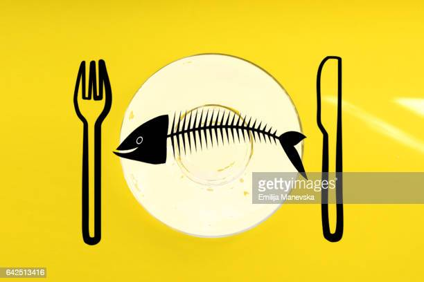 drawing of a fish on a plate - malnutrition stock pictures, royalty-free photos & images