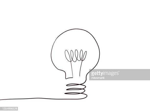drawing of a light bulb - lineart stock-fotos und bilder