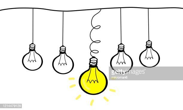 drawing of a light bulbs in a row - vector illustrations stock pictures, royalty-free photos & images