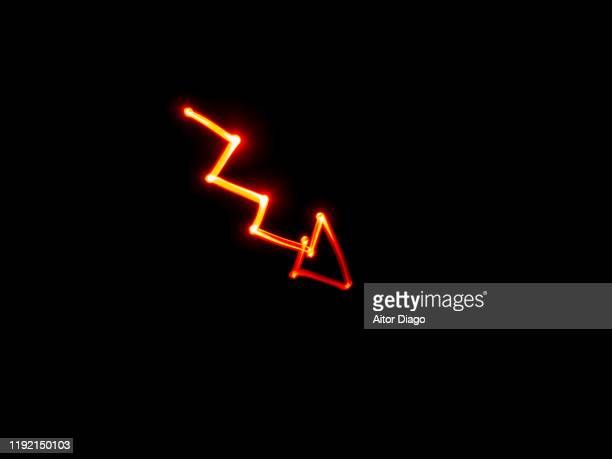 drawing of an arrow pointing down.  it is a period of economic crisis. - recessed lighting stock pictures, royalty-free photos & images