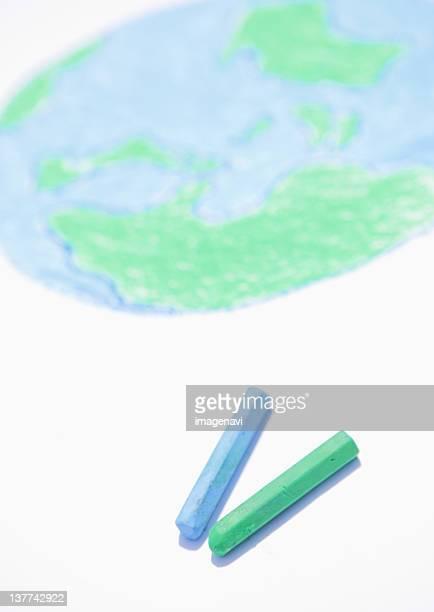 Drawing of globe and crayons