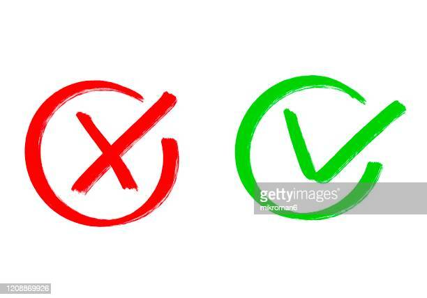 drawing of green tick check mark and red cross - positive emotion stock pictures, royalty-free photos & images
