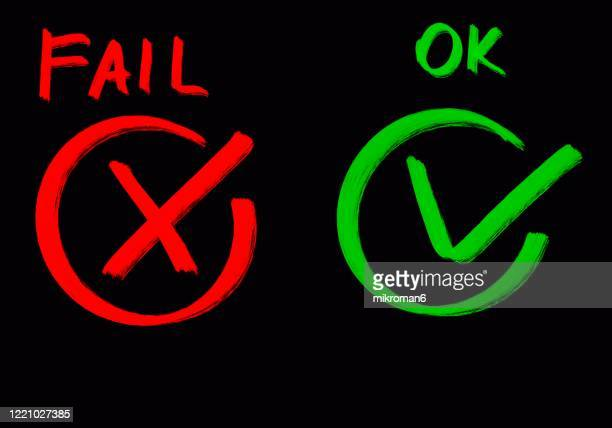 drawing of green tick check mark and red cross - mistake stock pictures, royalty-free photos & images