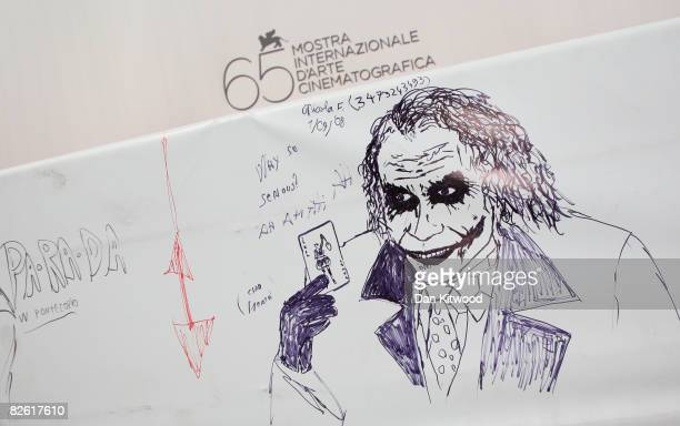 A drawing of Heath Ledger starring the Joker in his last movie 'Batman The Dark Knight' is seen near the red carpet during the 65th Venice Film...
