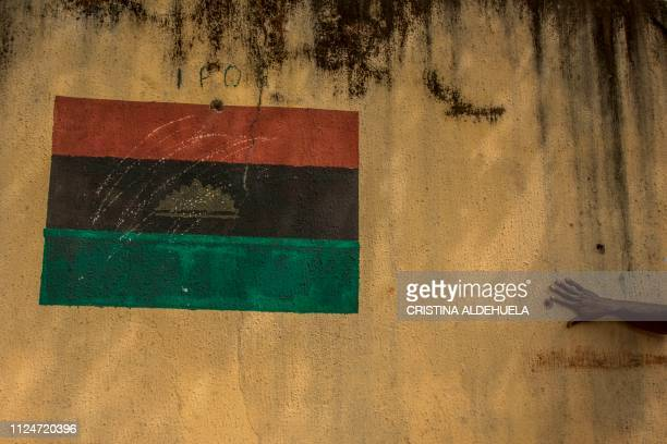 TOPSHOT A drawing of the Biafran flag adorns a wall in Umuahia one of the proBiafran separatist regions on February 13 ahead of Nigeria's...