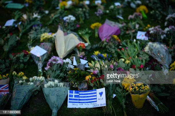 Drawing of the Greek flag is seen among the floral tributes outside Windsor Castle following the death of Prince Philip, on April 09, 2021 in...