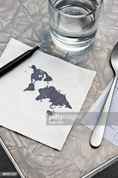 drawing of the map of the world on a table nakpin