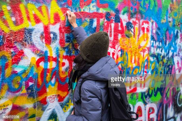 drawing on the lennon wall, prague, czech republic - vsojoy stock pictures, royalty-free photos & images