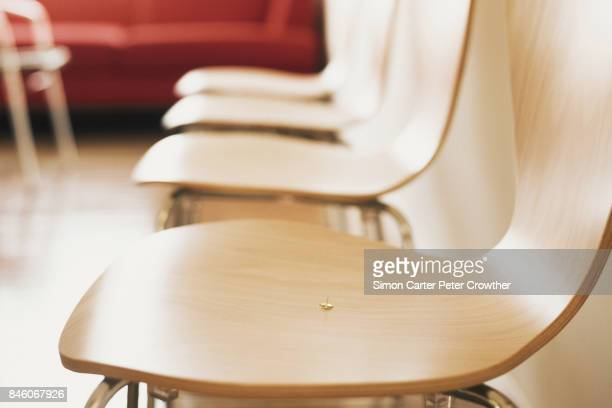 drawing pin on chair, close-up. - push pin stock pictures, royalty-free photos & images