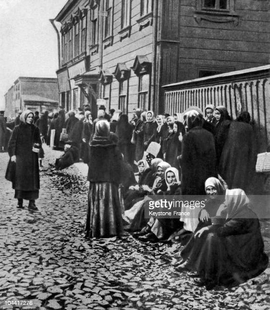 A drawing representing Russian women lined up and waiting in front of a store during the famine which struck the country from approximately 1917 to...