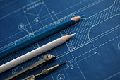 Drawing tools lying over blueprint paper