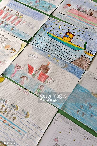 Drawings created by students relating to the recent shipwreck off the Italian coast are displayed in the Elementary School of Lampedusa on October 7...