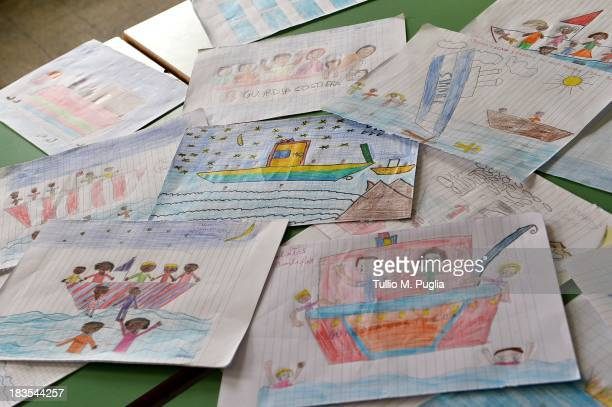 Drawings created by students relatingt to the recent shipwreck off the Italian coast are displayed in the Elementary School of Lampedusa on October 7...