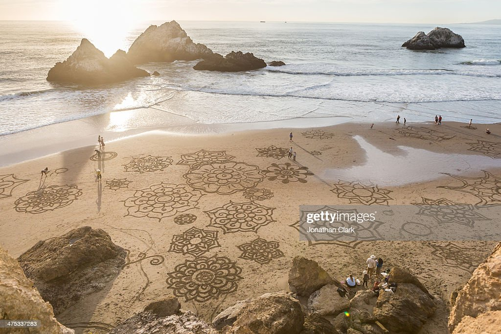 Drawings in the sand on the beach in San Francisco : Stock Photo
