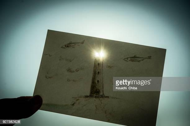 drawn lighthouse - kouichi chiba stock photos and pictures
