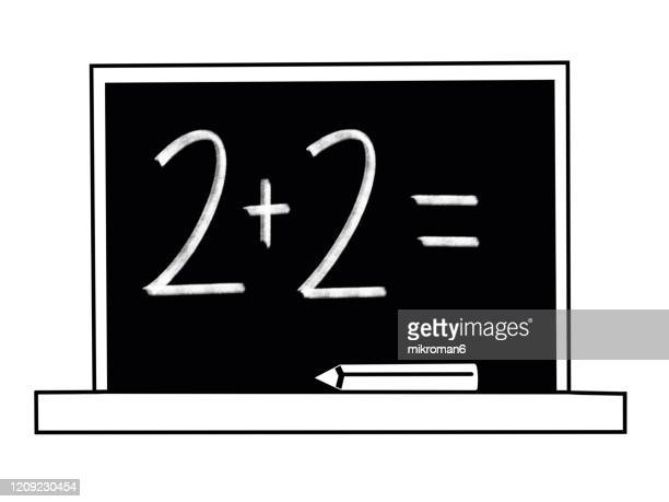 2+2 drawn with chalk on blackboard - number 2 stock pictures, royalty-free photos & images