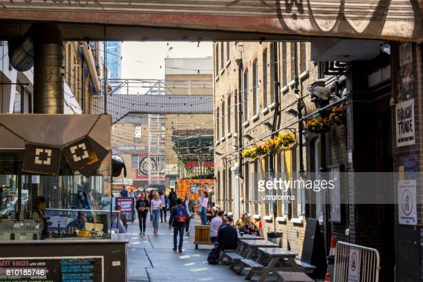 dray walk off brick lane in london - east london stock pictures, royalty-free photos & images