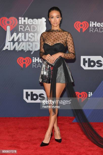Draya Michele arrives at the 2018 iHeartRadio Music Awards which broadcasted live on TBS TNT and truTV at The Forum on March 11 2018 in Inglewood...