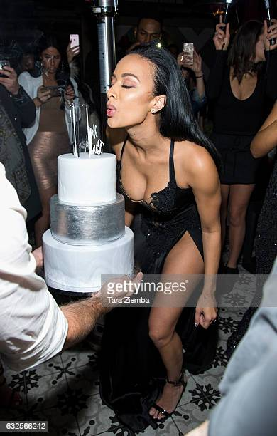 Draya Michele blows out her birthday candles during her birthday party at Liaison Lounge on January 23 2017 in Los Angeles California