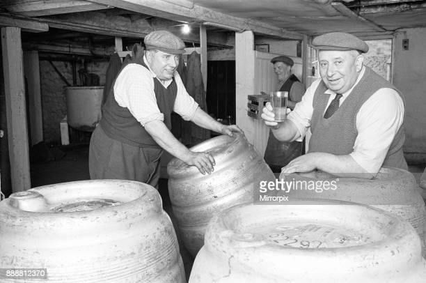 A Drayman samples the beer during a break in work at the Donnington Brewery 5th July 1963