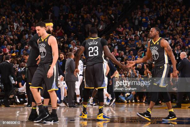 Draymond Green and Andre Iguodala of the Golden State Warriors react to a play during the game against the Dallas Mavericks on February 8 2018 at...