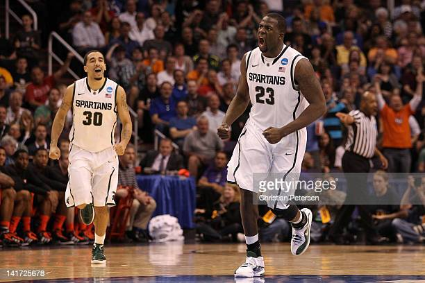 Draymond Green and Brandon Wood of the Michigan State Spartans react in the first half while taking on the Louisville Cardinals during the 2012 NCAA...