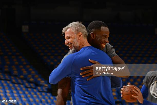 Draymond Green and Bruce Fraser of the Golden State Warriors smile and hug before the game against the Chicago Bulls on February 8 2017 at ORACLE...