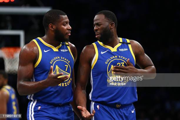 Draymond Green and Eric Paschall of the Golden State Warriors in action against the Brooklyn Nets at Barclays Center on February 05, 2020 in New York...