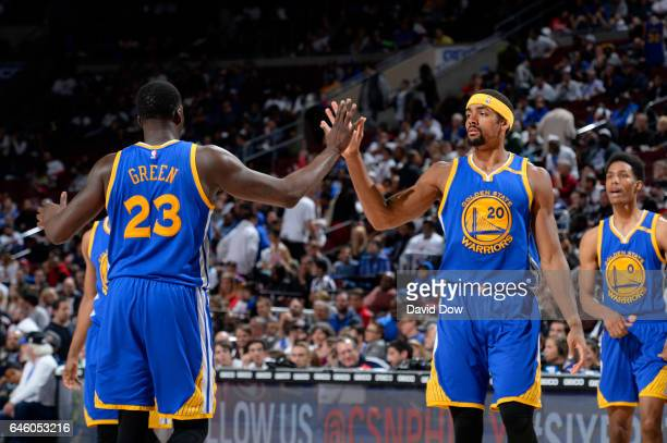 Draymond Green and James Michael McAdoo of the Golden State Warriors highfive during a game against the Philadelphia 76ers on February 27 2017 at the...