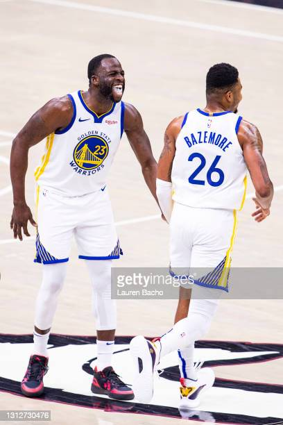 Draymond Green and Kent Bazemore of the Golden State Warriors celebrate during the fourth quarter of a game against the Cleveland Cavaliers at Rocket...