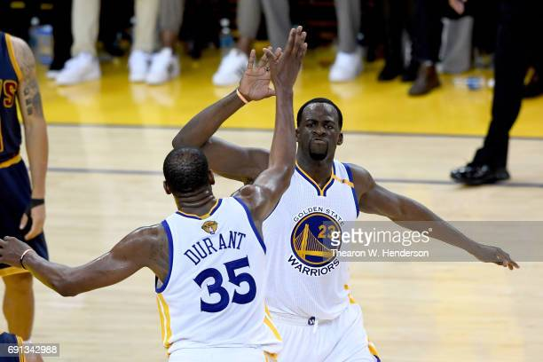 Draymond Green and Kevin Durant of the Golden State Warriors react after a play against the Cleveland Cavaliers in Game 1 of the 2017 NBA Finals at...
