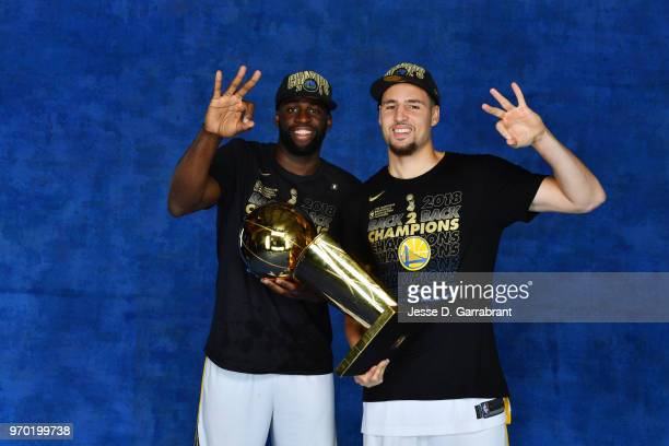 Draymond Green and Klay Thompson of the Golden State Warriors pose for a portrait with the Larry O'Brien Championship trophy after defeating the...
