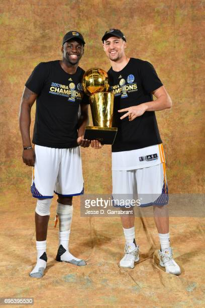 Draymond Green and Klay Thompson of the Golden State Warriors poses for a portrait with the Larry O'Brien Trophy after defeating the Cleveland...