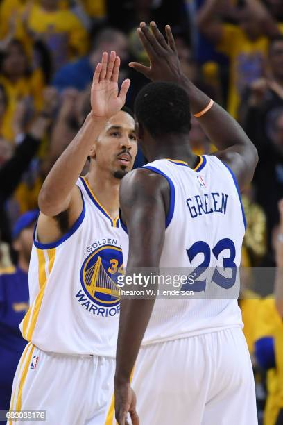 Draymond Green and Shaun Livingston of the Golden State Warriors celebrate after a basket against the San Antonio Spurs during Game One of the NBA...