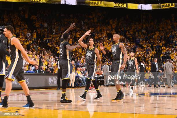 Draymond Green and Shaun Livingston of the Golden State Warriors high five in Game Two of the Western Conference Semifinals against the New Orleans...