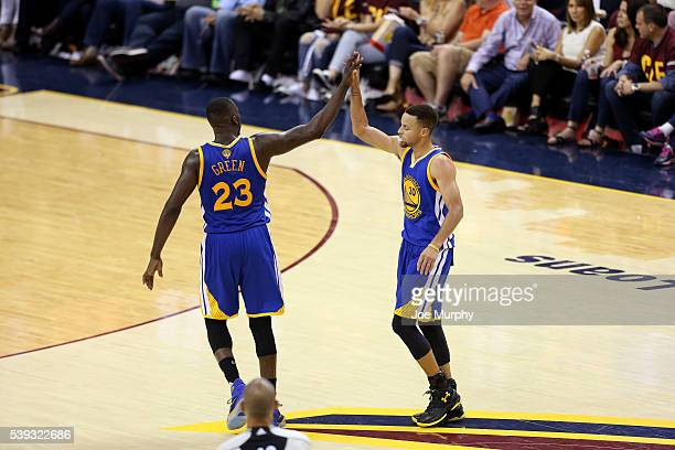 Draymond Green and Stephen Curry of the Golden State Warriors high five each other during the game against the Cleveland Cavaliers in Game Four of...