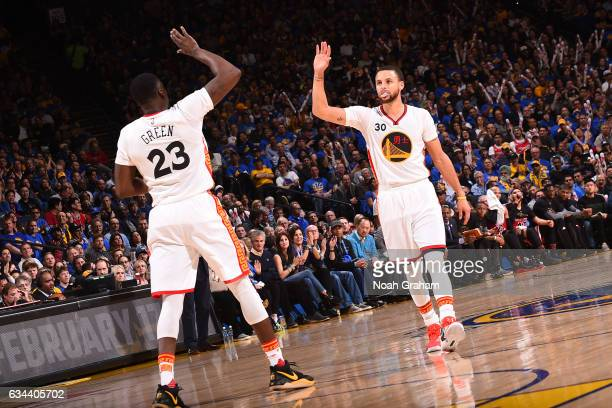Draymond Green and Stephen Curry of the Golden State Warriors high five during the game against the Chicago Bulls on February 8 2017 at ORACLE Arena...