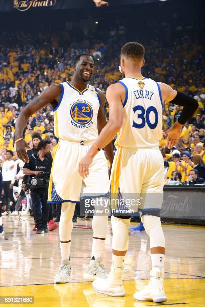 Draymond Green and Stephen Curry of the Golden State Warriors high five each other before the game against the Cleveland Cavaliers during Game One of...