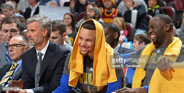 Draymond Green and Stephen Curry of the Golden State Warriors smiles from the bench against the Cleveland Cavaliers on January 18 2016 at Quicken...