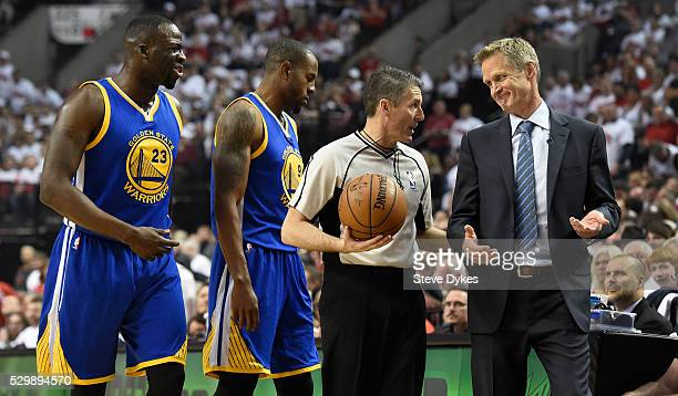 Draymond Green Andre Iguodala and head coach Steve Kerr of the Golden State Warriors have some words with referee Scott Foster during the first...