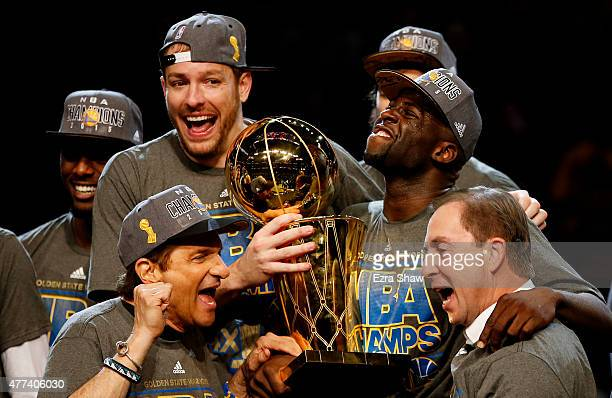 Draymond Green David Lee and Andrew Bogut of the Golden State Warriors celebrates with team owners Peter Guber and Joe Lacob and the Larry O'Brien...