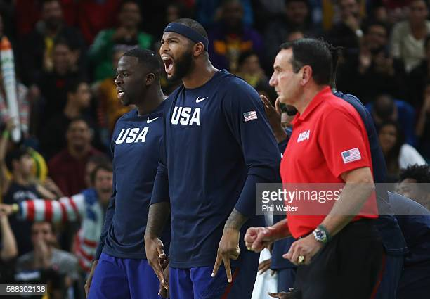 Draymond Green Demarcus Cousins and head coach Mike Krzyzewski of United States react during the Men's Preliminary Round Group A between Australia...