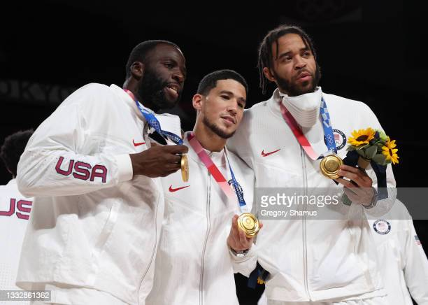 Draymond Green, Devin Booker, and Javale McGee of Team United States pose for photographs with their gold medals during the Men's Basketball medal...